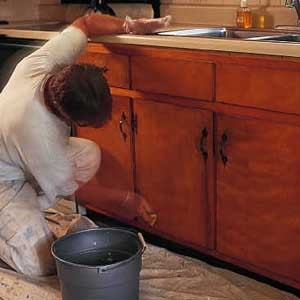 We always try to repaint or refinish the existing cabinets if possible.